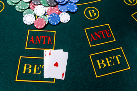 trickery: Poker chips on a poker table at the casino. Closeup. two aces, a winning combination. Chips winner Stock Photo
