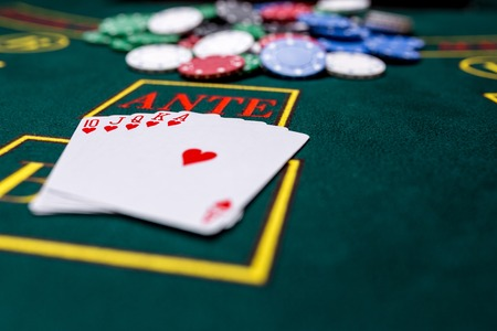 Poker chips on a poker table at the casino. Closeup. royal flush, winning combination. Chips winner Stock Photo