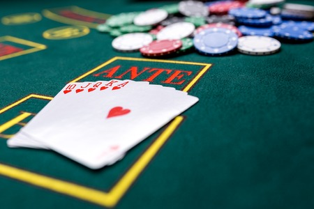 trickery: Poker chips on a poker table at the casino. Closeup. royal flush, winning combination. Chips winner Stock Photo