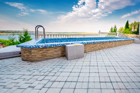 Luxury swimming pool at sunset. with blue sky Stock Photo