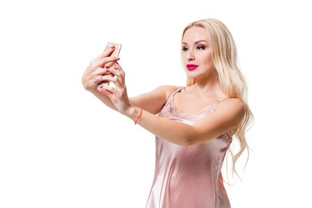 laugher: Young blonde doing selfie on isolated white background. Selfie time. Young beautiful woman in silk dress