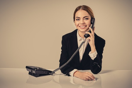 business relationship: Portrait of young woman sitting at the table and working.