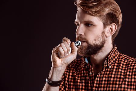 joven fumando: young man smoking electronic cigarette
