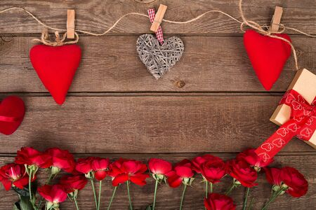 bunch of hearts: Valentine background of gift box, hearts and bunch  red roses on wood. Space for copy.