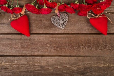 bunch of red roses: Valentine background of hearts and bunch  red roses on wood. Space for copy.