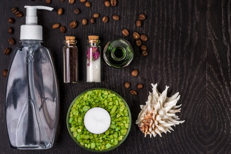 soaps, bath salt, mask on wood table background. spa