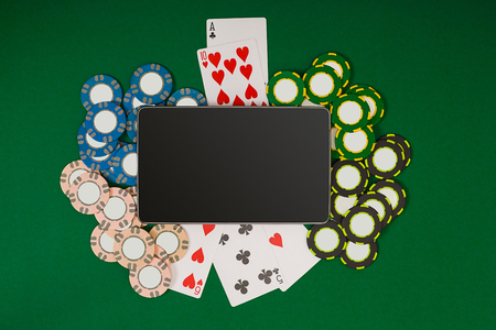 computer club: Online poker game with digital tablet, chips and cards Stock Photo