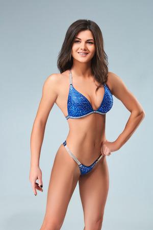 Brunette in blue bikini