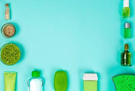Spa set: soap, mask, oil, sea salt on blue background