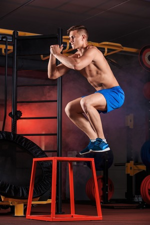 Man box jumping at a crossfit style gym. Stock Photo