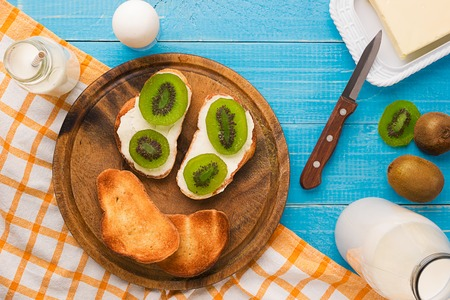 hurried: Breakfast table with bread, milk butter and fruits. Top view. Still life Stock Photo