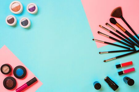 Top view on set of cosmetics for professional make-up on blue background