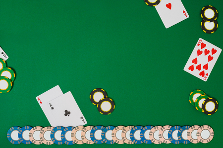 View from above with copy space. Banner template layout mockup for online casino. Green table, top view on workplace.