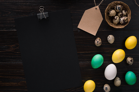 pascha: Greeting card with paschal eggs on rustic, wood table