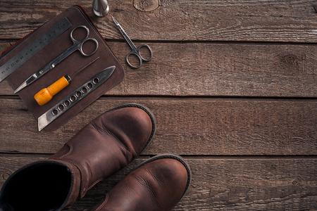 saddler: Leather handbag. Work place craftsman in a workshop. Top view