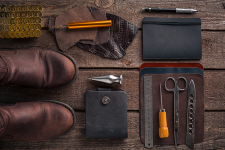 saddler: Leather products. Work place craftsman in a workshop. Top view