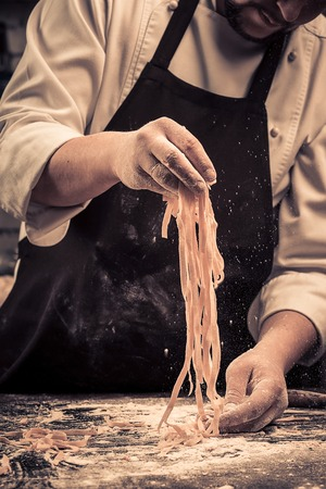 The chef makes fresh spaghetti from scratch.