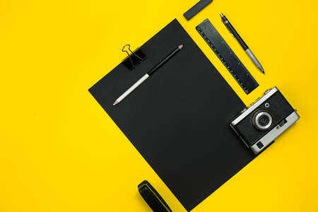 office stapler: Black objects from the office on a yellow background. Work and creativity. Top view.