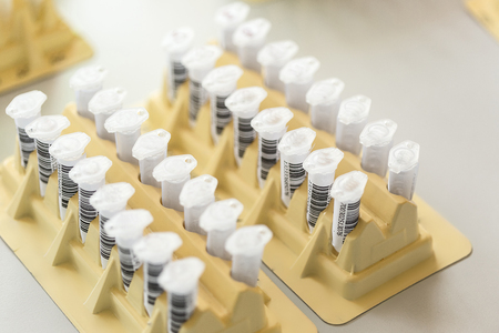 Test tubes arranged on medical trolley Stock Photo