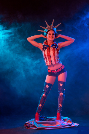 Young woman in stage costume of striptease dancer posing