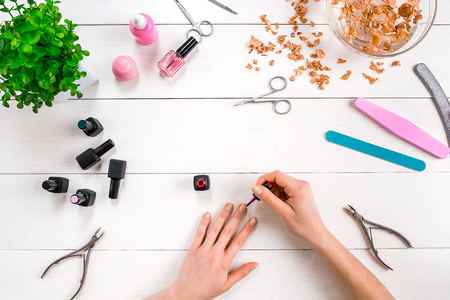 Paint your own nails. Manicure set and nail polish on wooden background