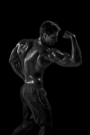 Fuerte, atlético, hombre, condición física, modelo, posar, espalda, músculos, tríceps Foto de archivo - 78824163