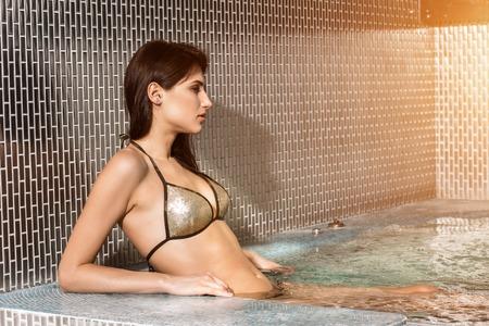 Portrait of beautiful woman in spa jacuzzi