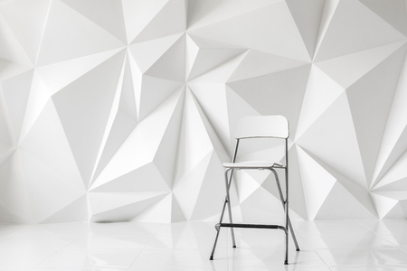 raytracing: Modern chair on abstract background of polygons on white background.