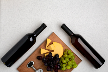 Bottles of red and white wine on white background from top view Stock Photo