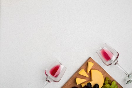 Glasses with red wine on white background from top view Stock Photo