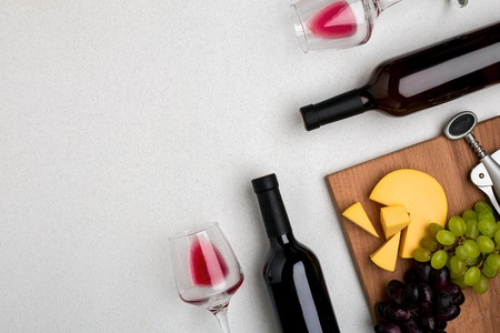 Two glasses of red wine, cheese and grapes. Top view Stock Photo