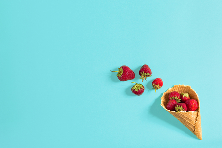 Fresh strawberry in waffle cone. Creative food concept. Flat lay, top view. Copy space. Still life mockup flat lay