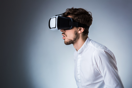 Side view of a young guy using a VR headset