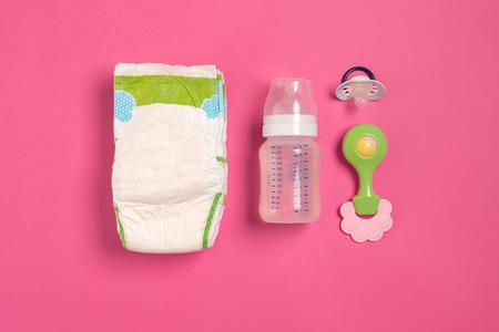 Baby care accessories and diapers on pink background. Top view 写真素材