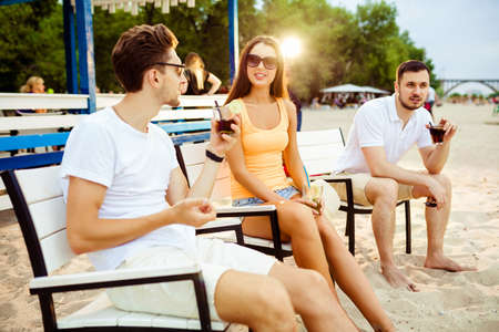 lipno: Young people enjoying summer vacation sunbathing drinking at beach bar Stock Photo