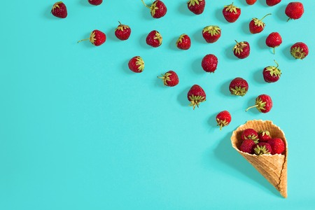 Strawberry in a waffle horn on a blue background Stock Photo