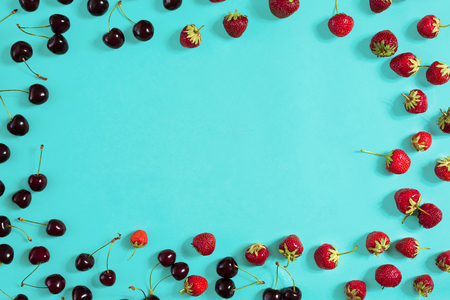 Strawberry and cherries on a blue background