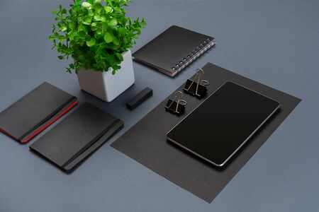 office stapler: Set of black office stationery on a gray background, flat lay