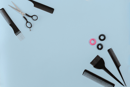 Hairdresser set with various accessories on blue background