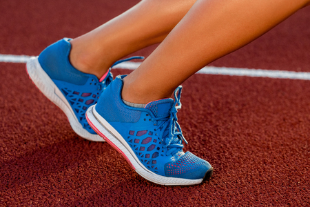 Close-up of womans legs on start before jogging