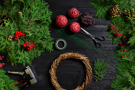 Manufacturer of Christmas decor with their own hands. Christmas wreath for the holiday. The new year celebration. Top view Stock Photo