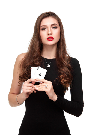 Sexy curly hair brunette posing with two aces cards in her hands, poker concept isolation on white background Stock Photo