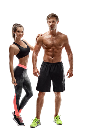 Sport, fitness, workout concept. Fit couple, strong muscular man and slim woman posing on a white background Reklamní fotografie