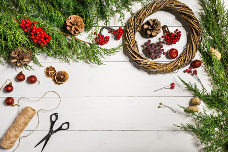 How to make christmas door wreath. The working process. The decorators workplace. Top view Stock Photo
