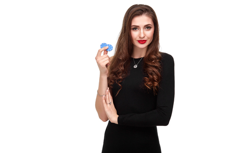 Sexy curly hair brunette posing with chips in her hands, poker concept isolation on white background Stock Photo