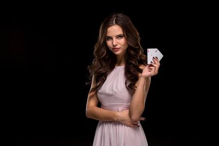 Attractive young woman holding the winning combination of poker cards