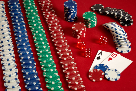 Two cards and chips on a red background. Big bet of game money. Cards - Ace and Ten. Your distribution at the table Stock Photo