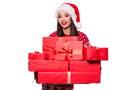 A beautiful young female overjoyed, holding many gifts in her hands