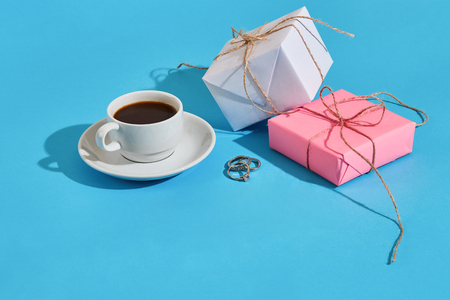 Valentines day greeting card. White coffee cup and gift boxes o Stock Photo