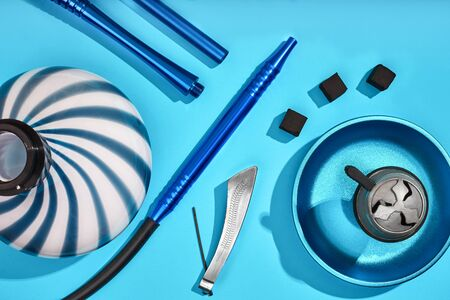 Top view of Hookah parts on light blue background. Still life. Copy space. Flat lay Stock Photo
